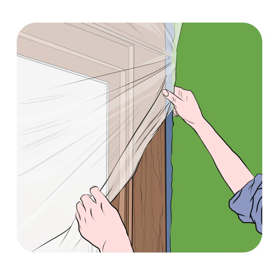using plastic and wide tape to protect windows and doors