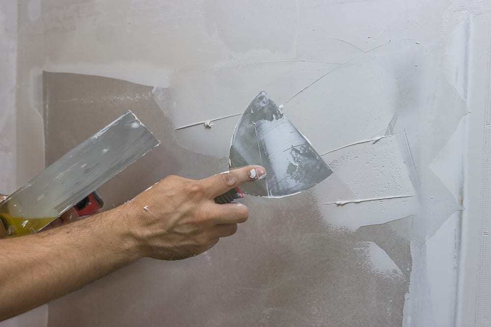 applying plaster to wall
