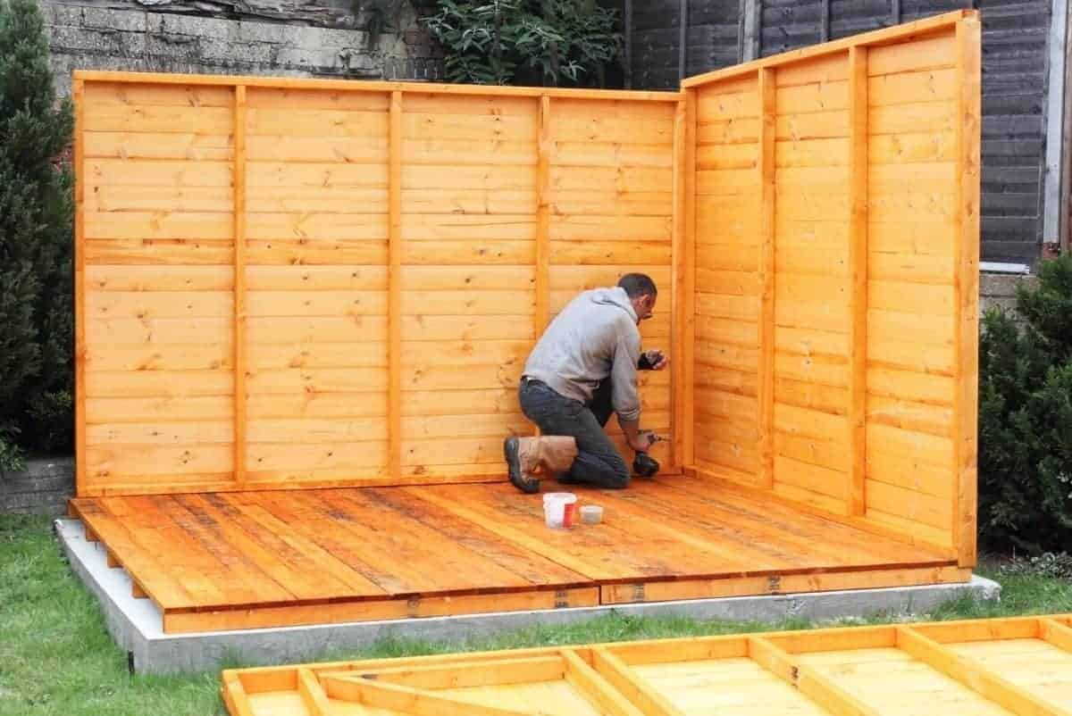 man building a shed