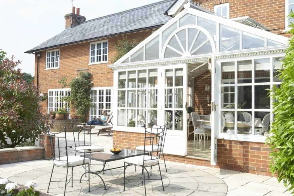 house with conservatory and patio