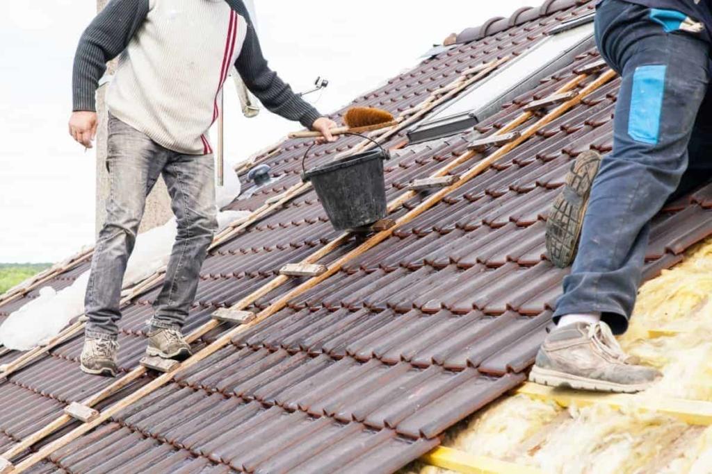 men replacing a roof