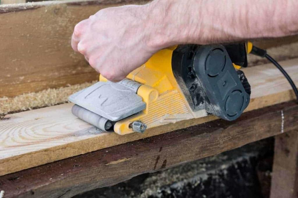 belt sander sanding wood