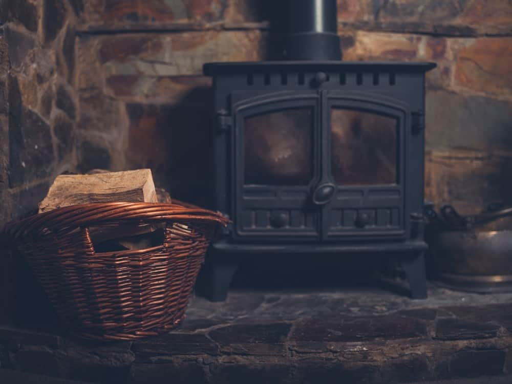 log burner and basket of firewood