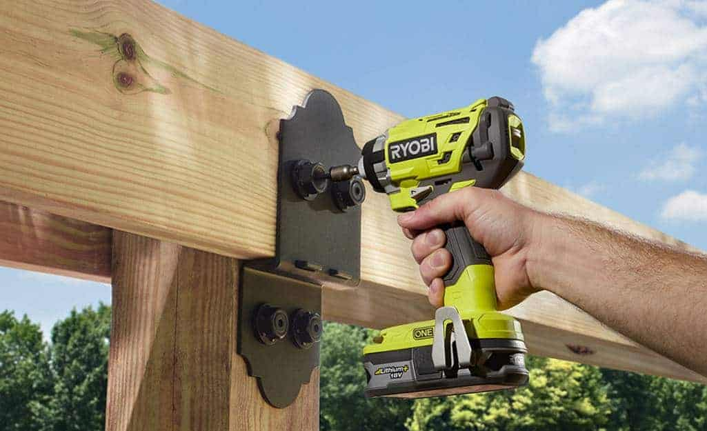 impact driver driving screws into wood