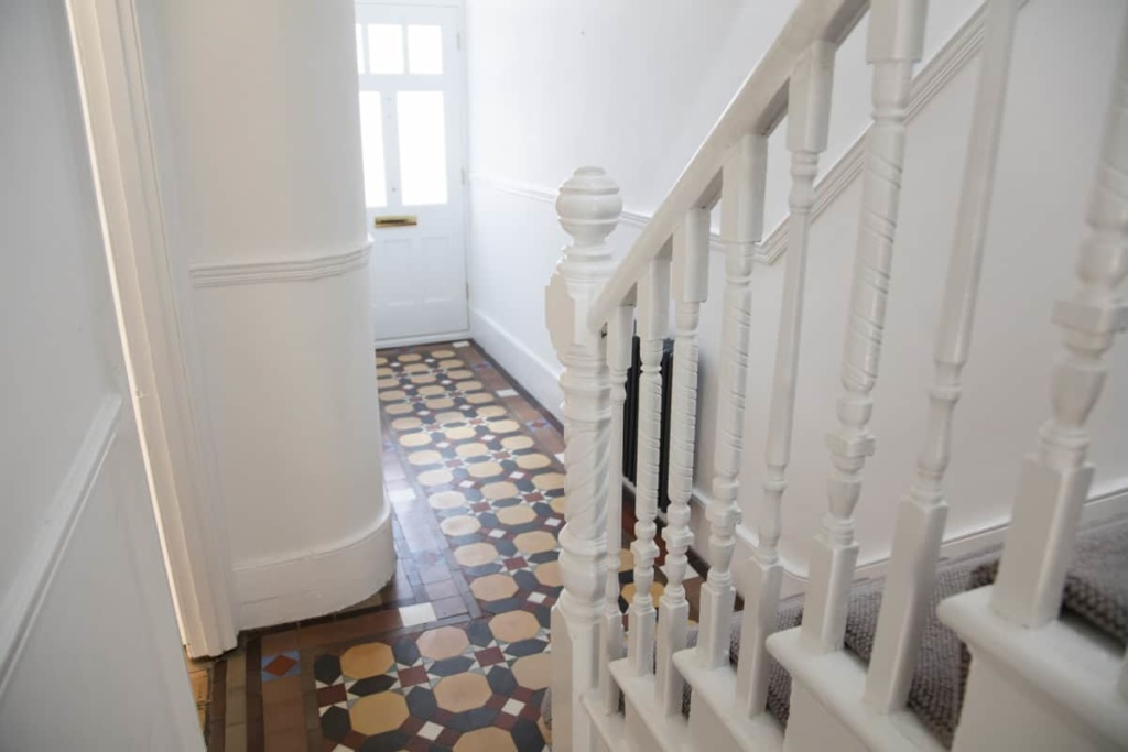 staircase with white banisters