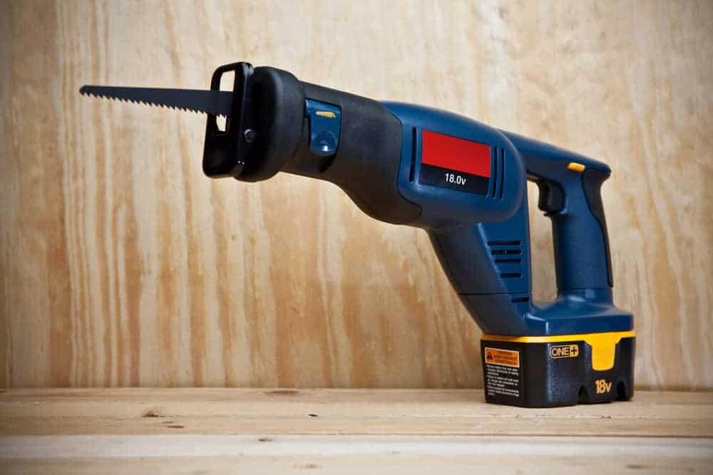 reciprocating saw sitting on wood blanks