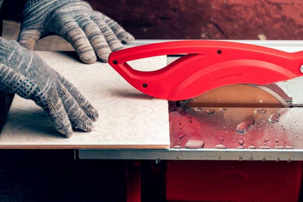 man using tile saw