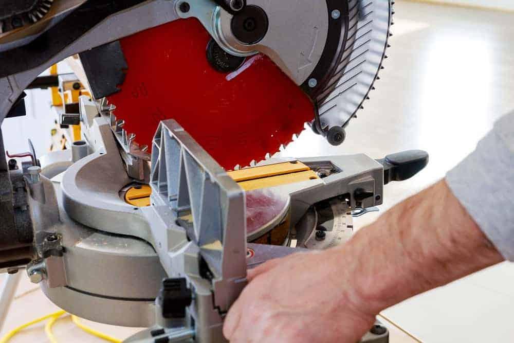 man using mitre saw