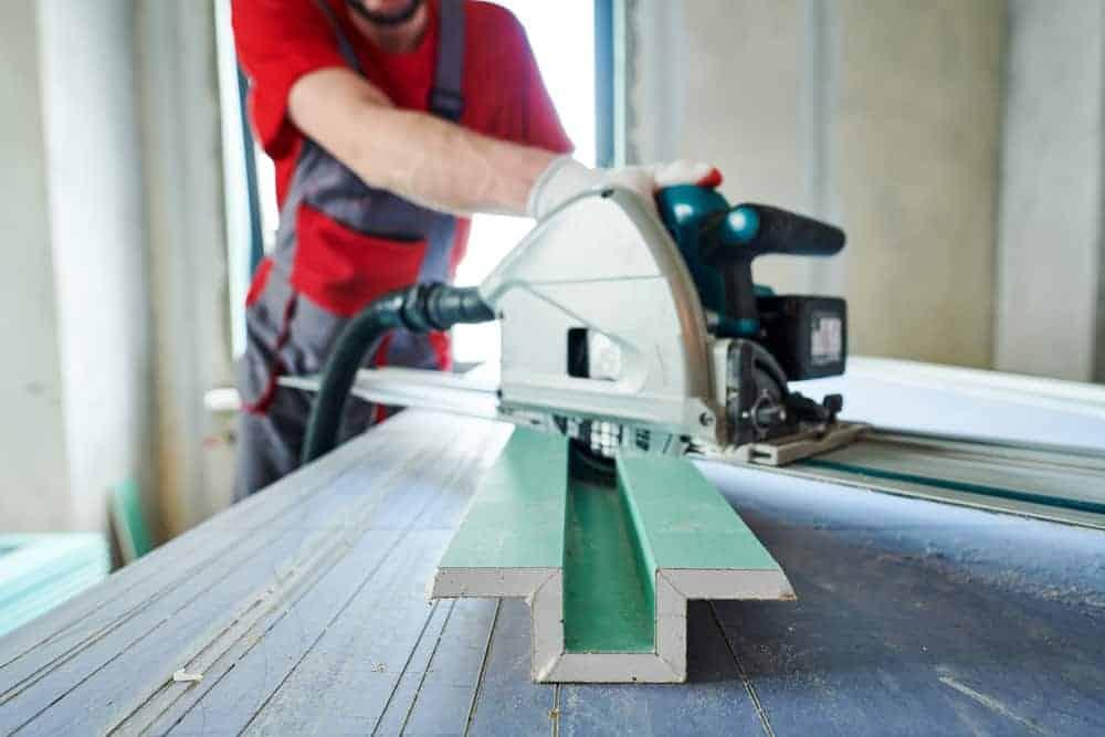 man using plunge saw