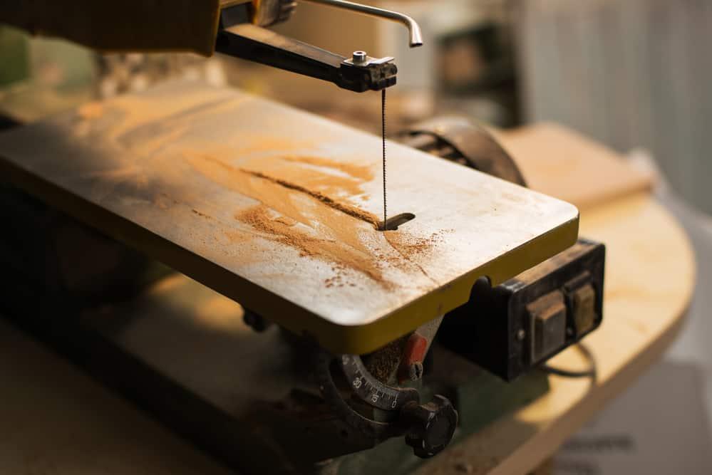 scroll saw with sawdust on it