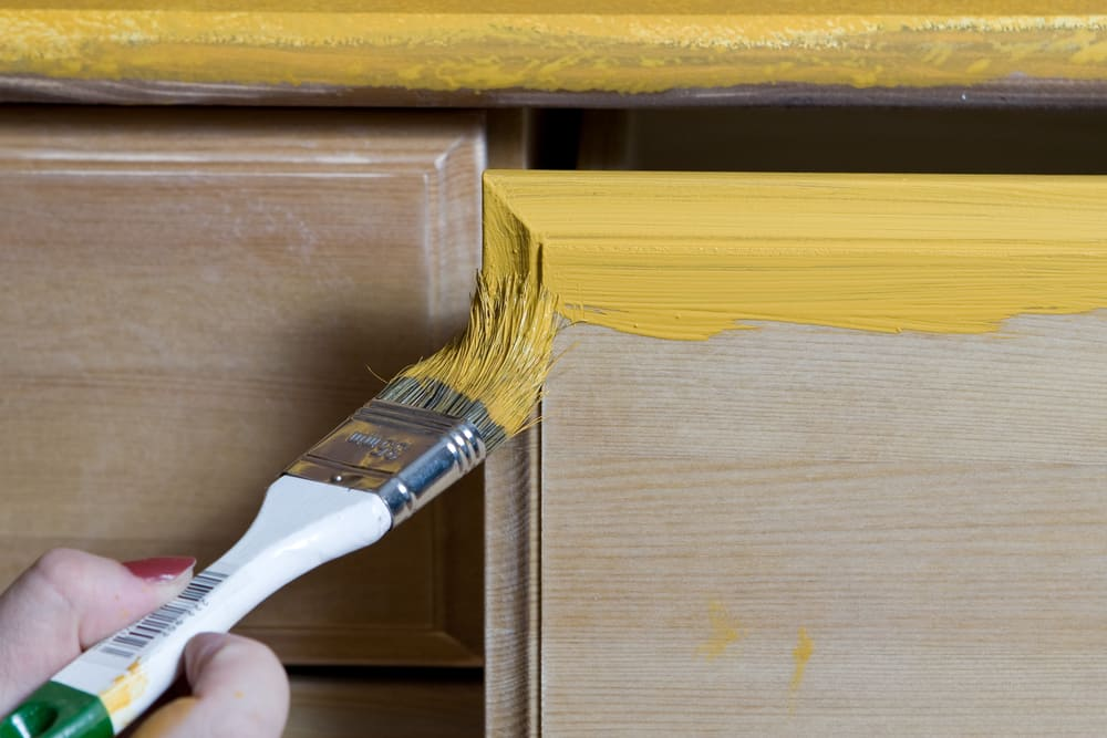 woman painting woodwork