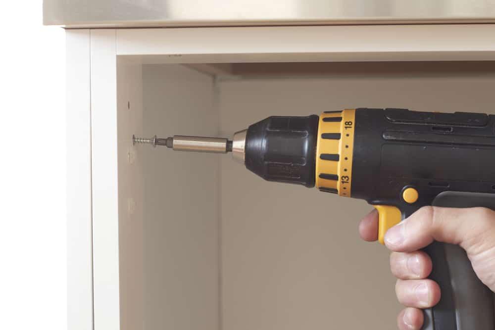 electric screwdriver attaching screw