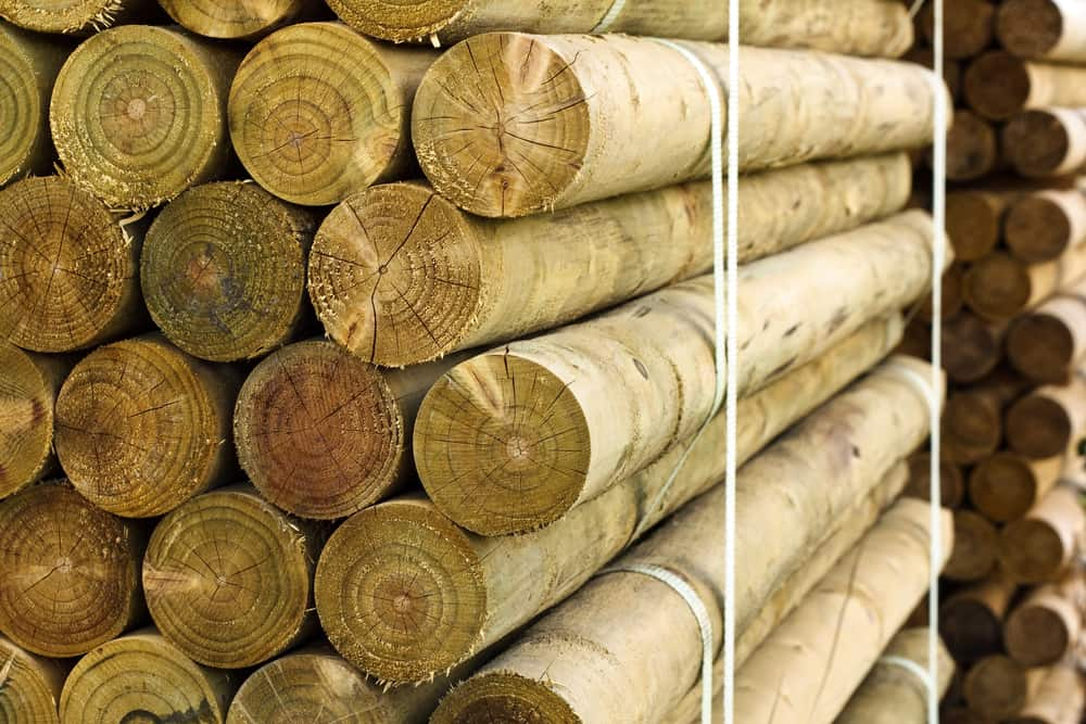 stacked fencing posts